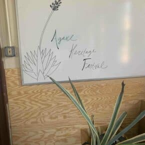 A sign for the Agave Heritage Festival